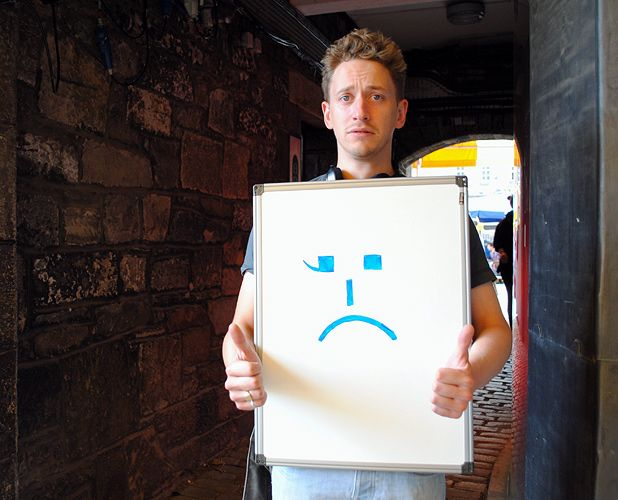 John Robins pictures his Fringe show as a confused smiley