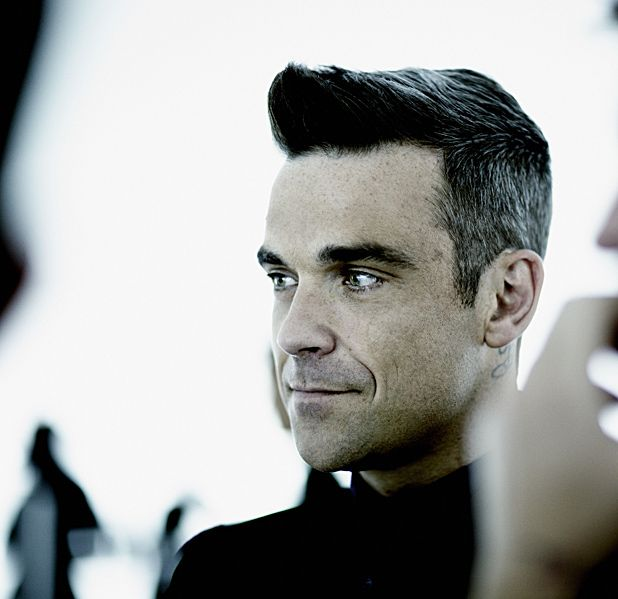 Robbie Williams returns to solo performing with a series of 'intimate' gigs