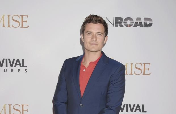 Orlando Bloom Jokes About Those Naked Paddleboarding Pics