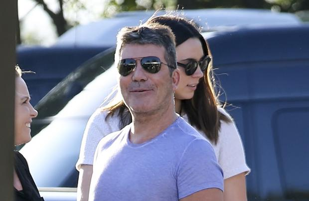 Simon Cowell offers to pay for dancer's spinal surgery