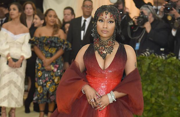 The Symbolic Meaning Behind Nicki Minaj's Red Hot 2018 Met Gala Look